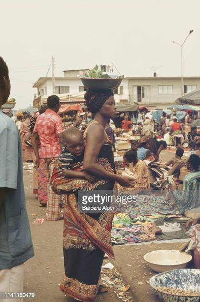 People shopping at a market in Adjamé Ivory Coast February 1975