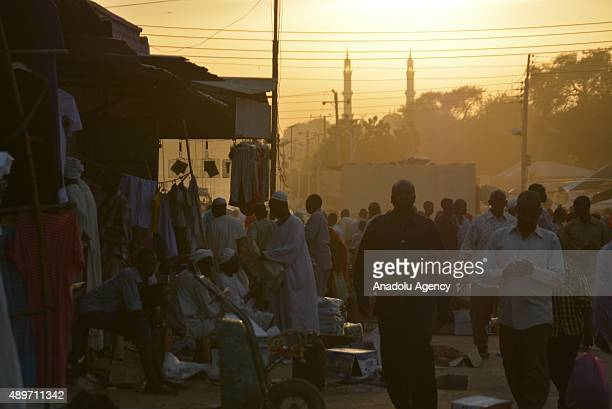 People shopping at a marketplace for upcoming Muslim sacrificial festival Eid alAdha in the capital city of North Darfur AlFashir in Sudan on...