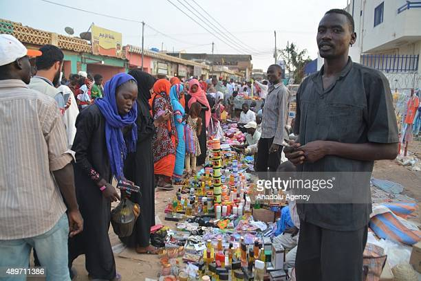 People shopping at a marketplace for upcoming Muslim sacrificial festival 'Eid alAdha' in the capital city of North Darfur AlFashir in Sudan on...