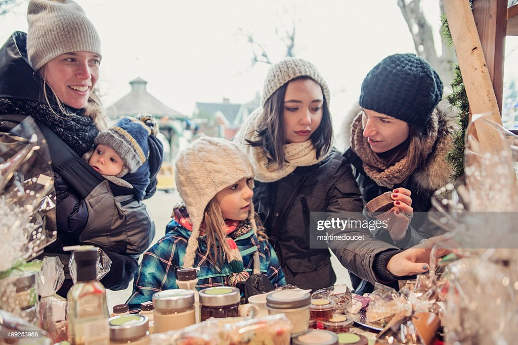 People shopping at an outdoors public market in winter. : Stock Photo