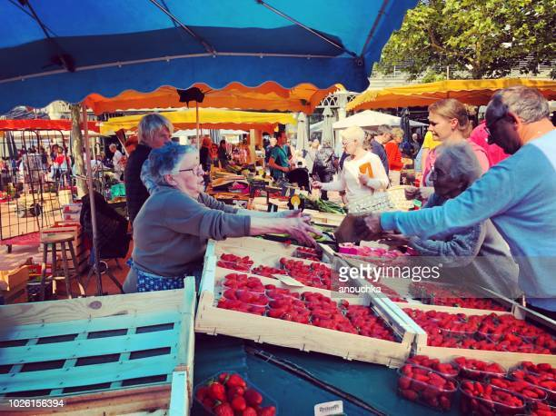 people shopping at arcachon municipal market, france - arcachon stock photos and pictures