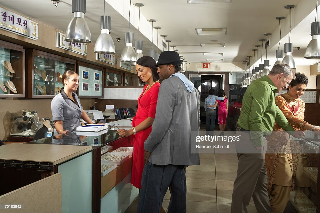 People shopping at department store : Stock Photo