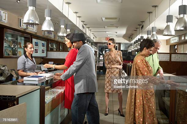 People shopping at department store