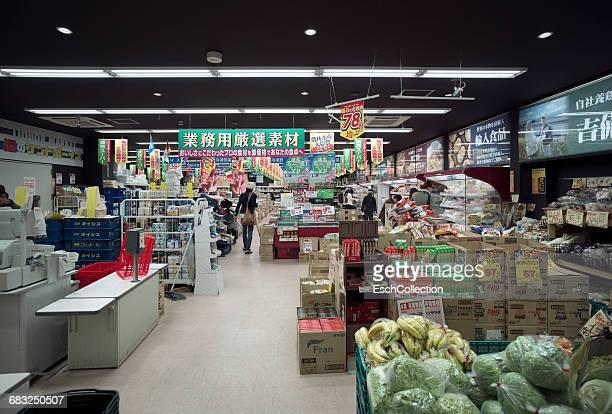 People shopping at neighborhood supermarket