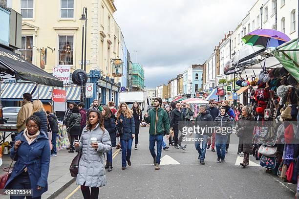 People shopping at Portobello Road Market - London, UK