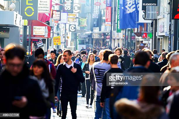 people shopping at sunny autumn day - pedestrian zone stock pictures, royalty-free photos & images