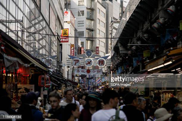 People shopping at the Ameya Yokocho market in Tokyo There are about 500 stores along the narrow lane which is visited by tens of thousands of people...