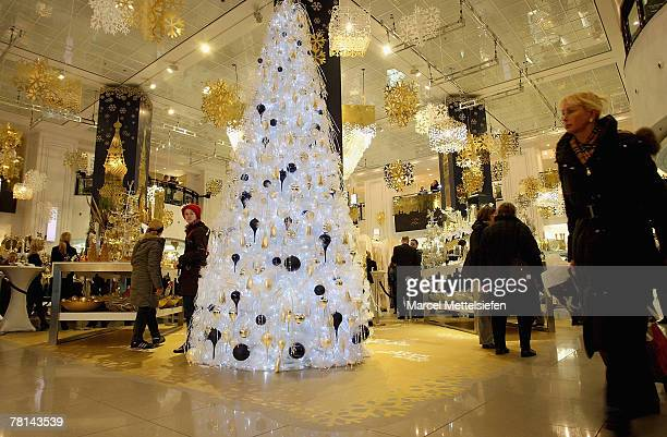 People shopping at the newly decorated Christmas floor at KaDeWe department store on November 29 2007 in Berlin Germany Photo Marcel Mettelsiefen