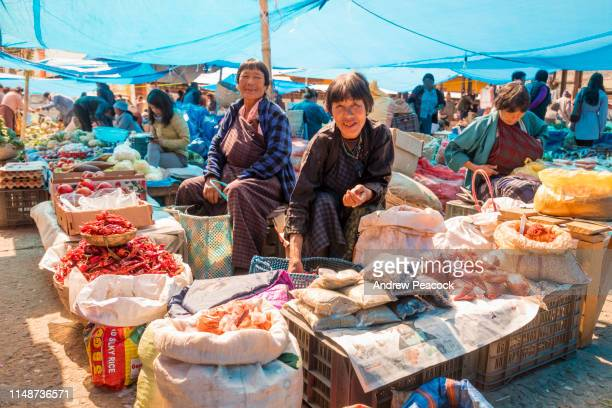 people shopping for produce at the paro weekend market - bhutan stock pictures, royalty-free photos & images