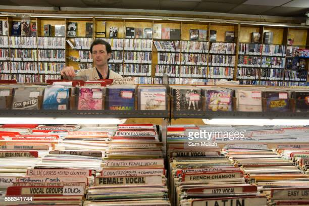 People shopping for vinyl in a record shop on 2nd November 2015 in London United Kingdom Music and Video Exchange is one of the few surviving record...