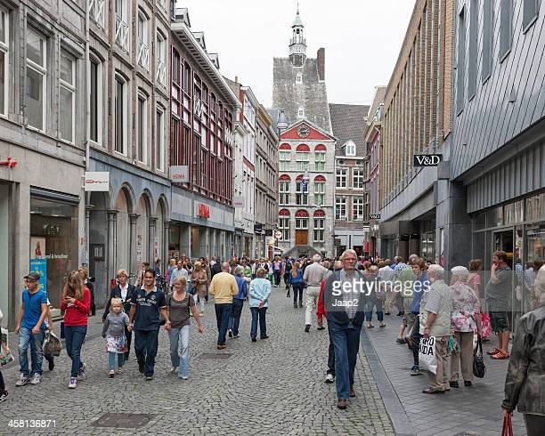 People shopping in a street downtown Maastricht, the Netherlands