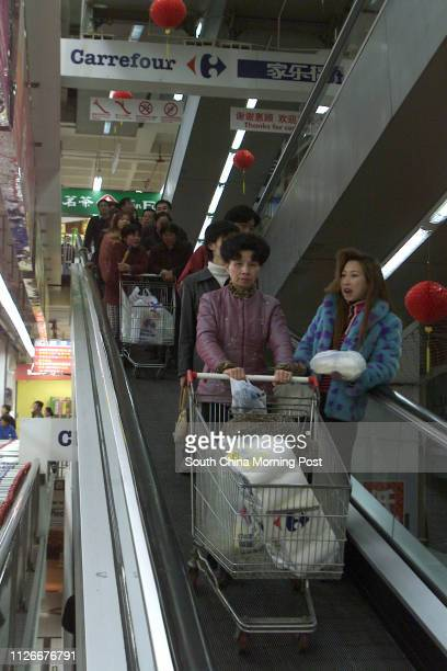 People shopping in Carrefour supermarket in Shanghai China 21 January 2003