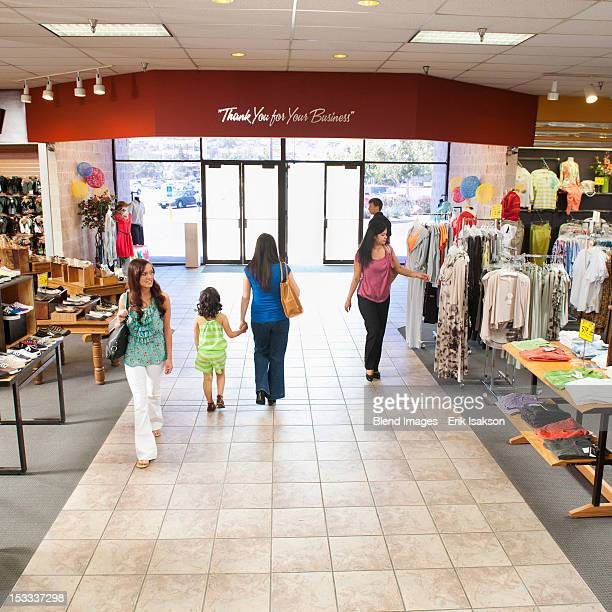 People shopping in clothing store