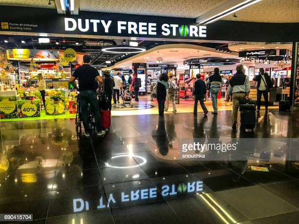 People shopping in Duty Free store in Lisbon Portela Airport, Portugal