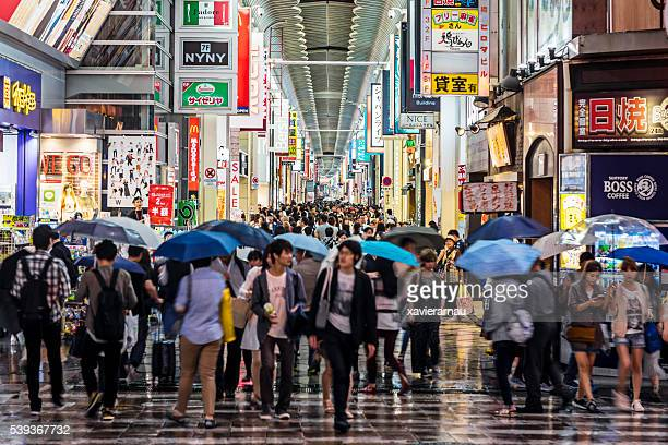 People shopping in Shinsaibashi on a rainy day