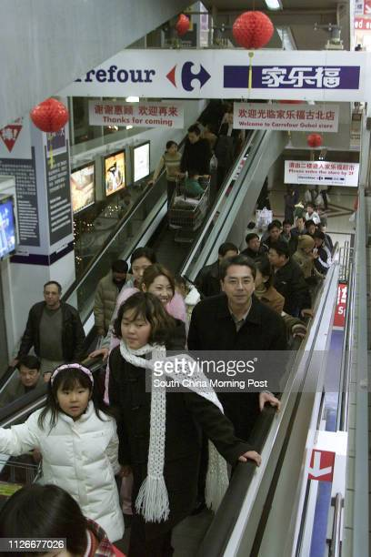 People shopping in the Carrefour supermarket in Shanghai China 21 January 2003