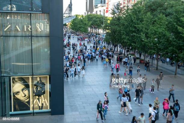 People shopping in Xidan business district According to the Chinese National Bureau of statistics the total sales of retail consumer goods in April...