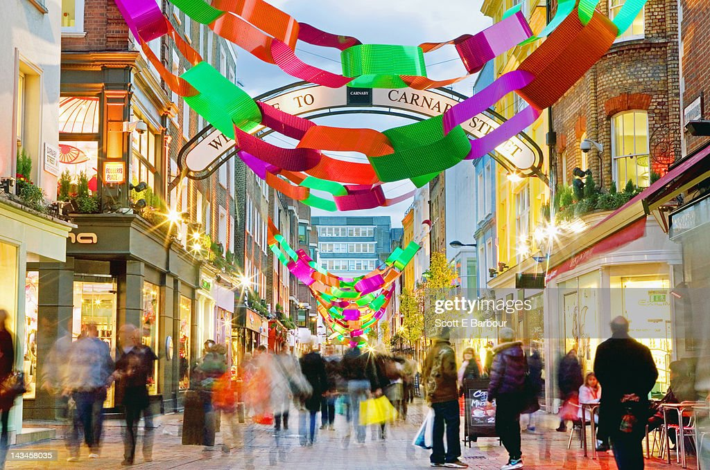 People shopping on Carnaby Street at Christmas : Stock Photo