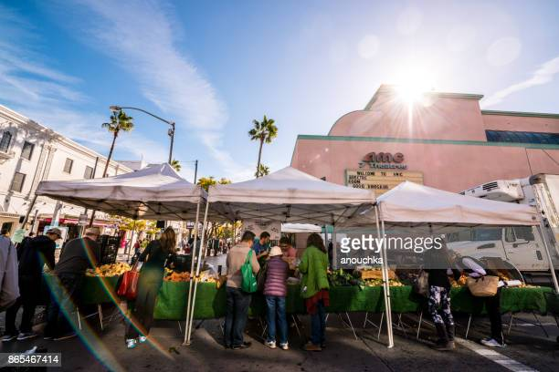 people shopping on santa monica farmer's market, california, usa - santa monica stock pictures, royalty-free photos & images
