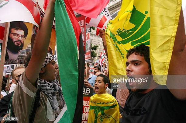 People shout and hold Hezbollah and lebanese flags as they take part in a march through central London 22 July 2006 protesting against Israeli...
