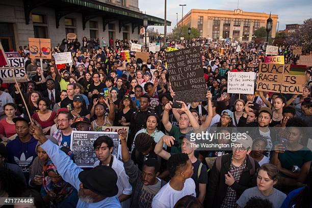 People shout and protest in front of Baltimore Penn Station as protests walk for the death of Freddie Gray around the city in Baltimore MD on...