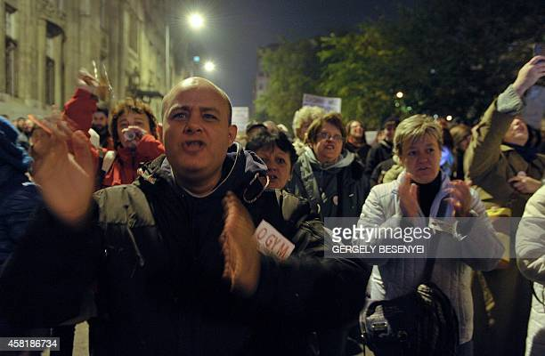 People shout antigovernment slogans against the government's new tax plan for the introduction of the internet tax next year in Budapest on October...
