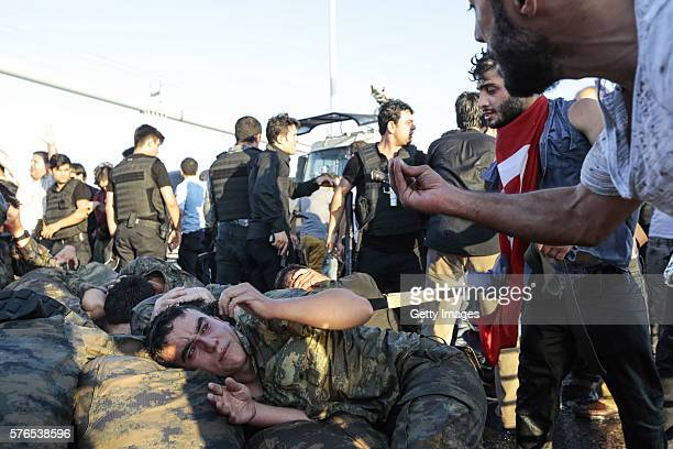 People shout at the soliders involved in the coup attempt who have surrendered on Bosphorus bridge on July 16 2016 in Instabul Turkey Istanbul's...