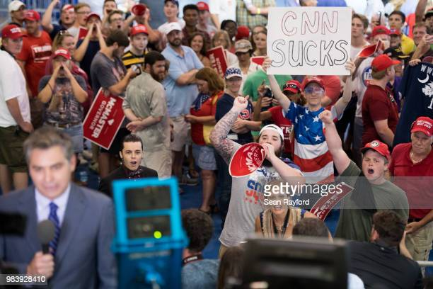 People shout behind CNN reporter Jim Acosta before a campaign rally for South Carolina Governor Henry McMaster featuring President Donald Trump at...