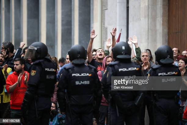 People shout 'Independence' as police try to control the area as people attempt to cast their ballot today at a polling station in the referendum...