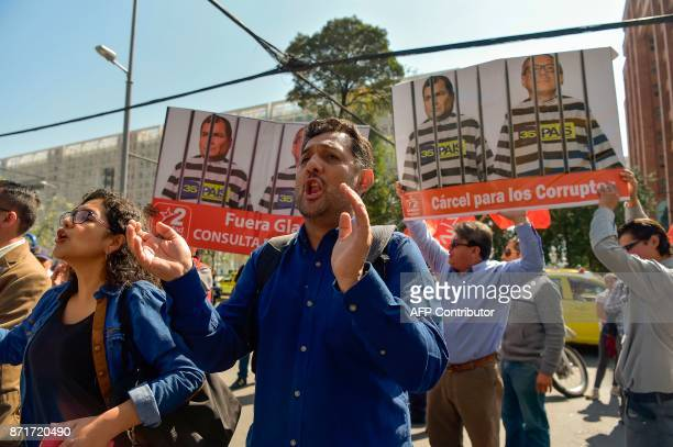 People shout slogans against Ecuador's suspended Vice President Jorge Glas in front of the National Court of Justice during a hearing where the...