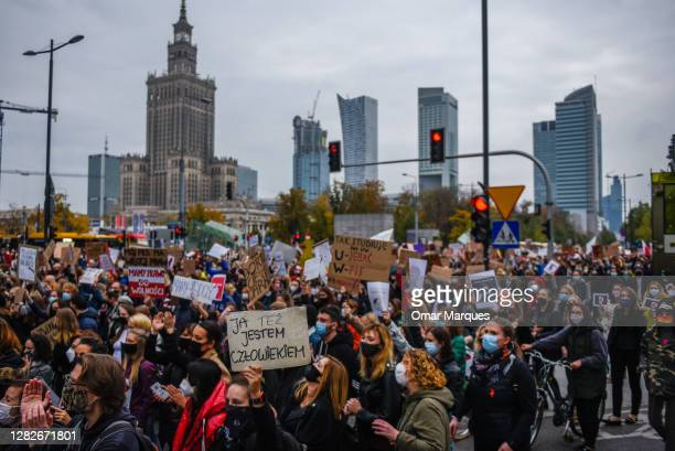 People shout slogans and hold banners as they participate in a National strike for the seventh day of protests against the Constitutional Court...