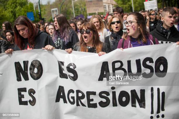 People shout slogans and hold banners reading 'it is not abuse it is assault' during a demonstration against the verdict of the 'La Manada' gang case...