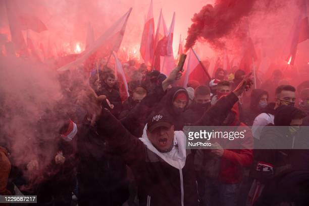 People shout slogans and hold Polish flags among smoke from flares on November 11, 2020 in Warsaw, Poland. After Warsaw's mayor, Rafal Trzaskowski,...