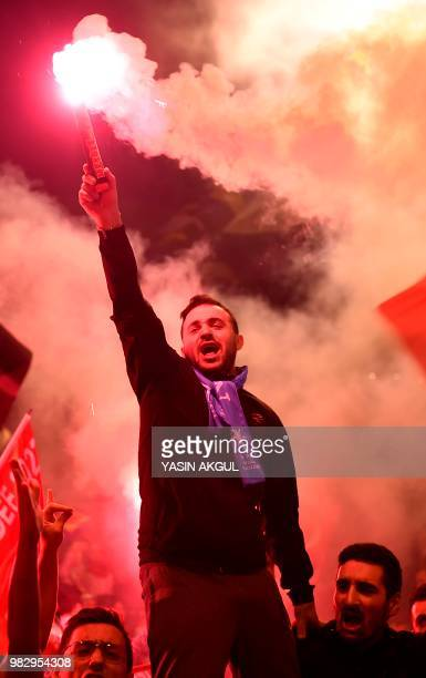 People shout slogans and let off flares outside the Justice and Development Party headquarters Istanbul on June 24 after counting of votes in...