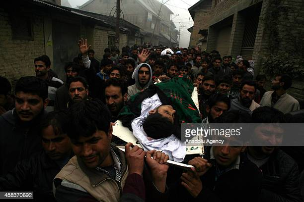 People shout slogans as they carry the bodies of two civillians killed by Indian soldiers during a funeral procession in Nowgam on the outskirts of...