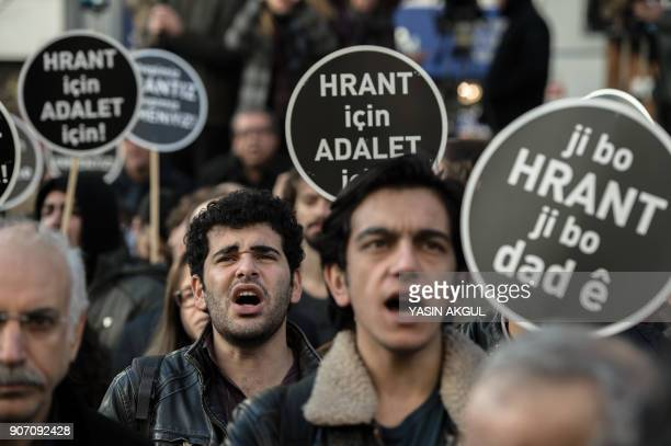 People shout slogans as they hold placards reading 'Justice for Hrant' in front of the offices of Armenian weekly newspaper 'Agos' during a rally...