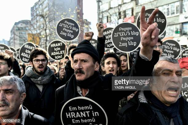 People shout slogans as they hold placards reading 'We all are Hrant we all are Armenians' in front of the offices of Armenian weekly newspaper...