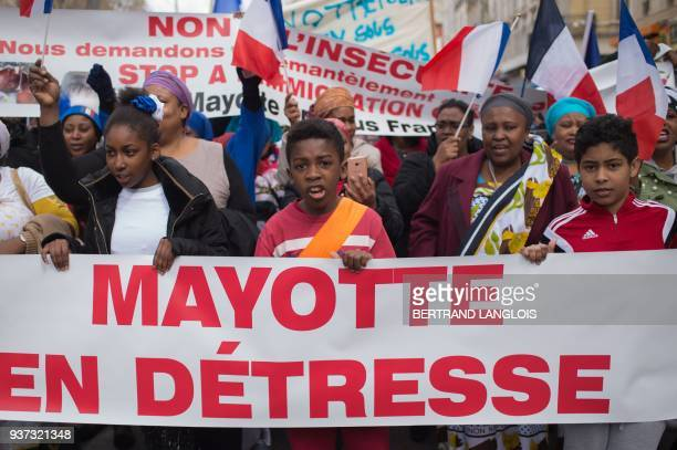 People shout slogans as they take part in a rally to protest against insecurity and immigration on the French Indian Ocean island of Mayotte on March...