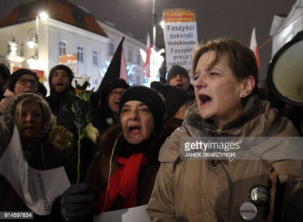 People shout slogans during a demonstration against a controversial new Polish bill regarding the Holocaust and the definition of Nazi death camps on...