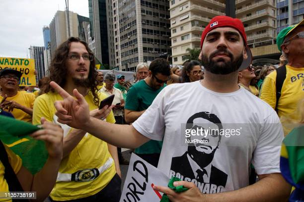 People shout slogans during a demonstration in support of the Lava Jato operation and against former President Luiz Inacio Lula da Silva on the day...