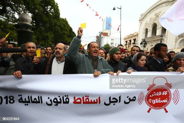 People shout slogans during a protest against new budget law and price hikes as they march to the governorship building in Tunis, Tunisia on January...