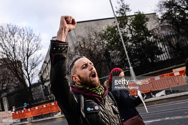 People shout slogans during a protest held in solidarity with the Washington DC Women's March in Dublin Ireland on January 21 2017