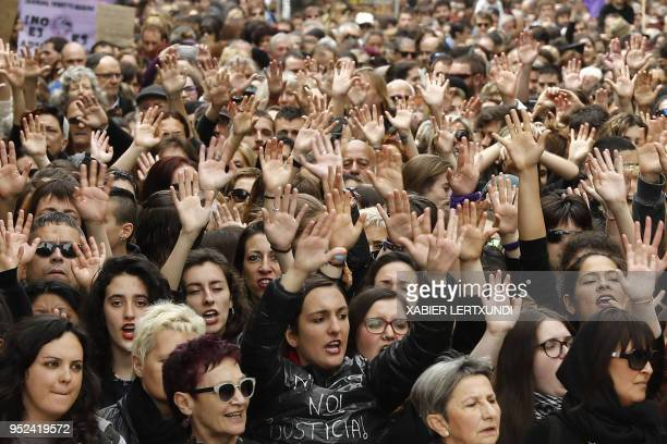 People shout slogans during a protest in Pamplona on April 28 2018 after five men accused of gang raping a woman at Pamplona's bullrunning festival...