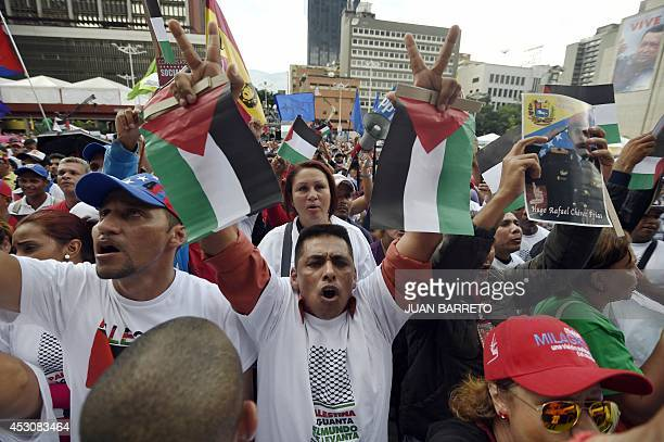 People shout slogans during rally in support of the Palestine people in a square in downtown Caracas on August 2 2014 Venezuelan Foreign Minister...