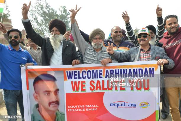 TOPSHOT People shout slogans near the IndiaPakistan border in Wagah on March 1 as they wait for the return of an Indian Air Force pilot being...