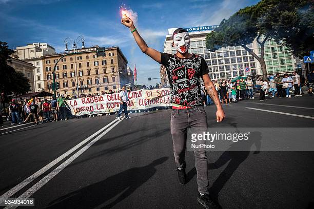 People shout slogans wave flags and lit flares during a demonstration called by the Movements for the Right to Housing to protest against forced...