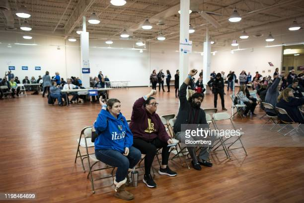 People show their eligibility wristbands in the undecided voter section during the firstinthenation Iowa caucus at the Southridge Mall in Des Moines...
