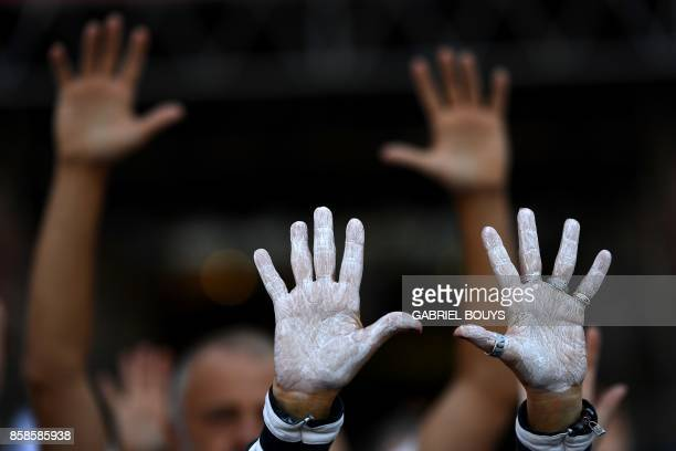 People show their hands painted in white during a demonstration called by the Let's talk association for dialogue in Catalonia in October 07 2017 at...