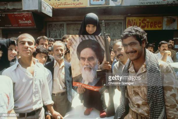 People show their support for Ayatollah Khomeini in the streets of Tehran