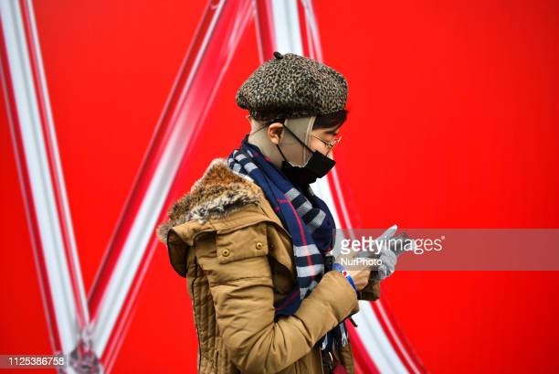 People showcase outfits and details as they attend events during London Fashion Week February 2019 on February 16 2019 in London England